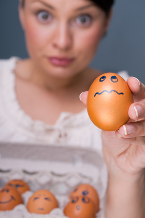 Woman with Egg © Kirill Kedrinski - Fotolia.com