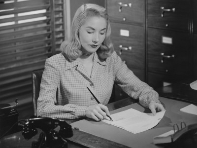 Vintage-lady-writing-at-desk-woman-50s-60s-retro