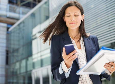 Businesswoman-using-cell-phone-in-office-169270562-5a06449f13f1290037a642df